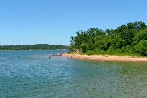 Lake Eufaula visitors swim at a beach near Texanna, Okla.