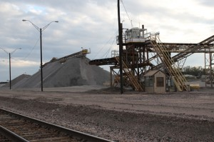 A pile of crushed limestone sits near the train tracks at Texas Industry's large mining operation near Mill Creek, Okla.