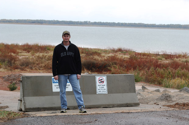 Jeff Converse of the Canton Lake Association stands in front of a boat ramp he says has been surrounded by mud and weeds since Oklahoma City withdrew water from the lake in January.