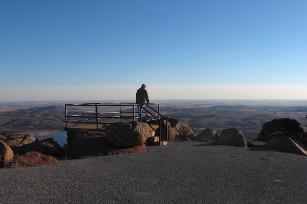 Meers area resident Bill Cunningham looks for haze over the Wichita Mountains from the top of Mt. Scott.