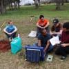 University of Oklahoma graduate students near Wellston, Okla., installing a seismometer to study central-Oklahoma's earthquake swarm