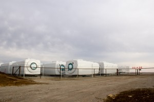 Turbine nacelles for an wind farm project are collecting at a staging area in Osage County.