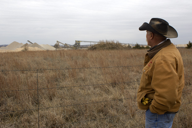 Johnston County Landowner Clyde Runyon just outside a limestone mining operation near Mill Creek, Okla.