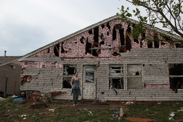 Lauren Gardner stands near a family members' house, which was destroyed by the May 20, 2013 tornado that ravaged Moore, Okla.