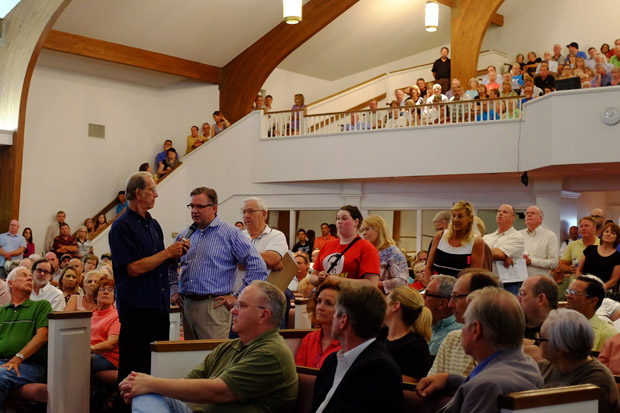 Shaken residents line up inside Edmond's Waterloo Baptist Church to voice concerns and ask representatives from the Corporation Commission and the state Geological Survey questions about recent earthquakes.