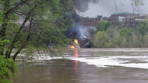 Flames and smoke are seen in an May 2014 oil-train derailment along Virginia's James River.