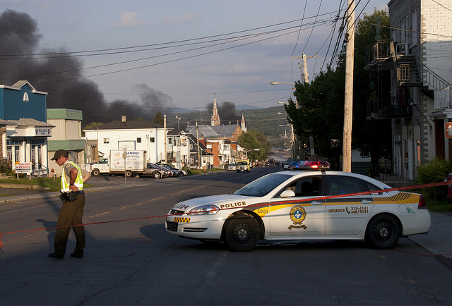 Smoke lingers a day after the Bakken crude oil train derailment in Lac-Mégantic, Quebec, which killed 47 people.