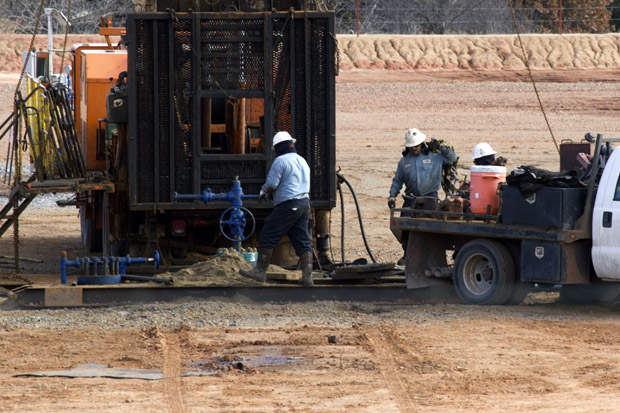 Workers with Shebester-Bechtel at an American Energy Woodford rig site in Payne County, Okla.