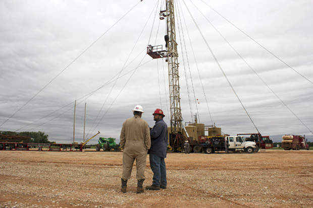 Jay Storm, left, the completions superintendent for Eagle Energy Exploration, and a service company worker oversee the plug-back of the George No. 1 saltwater disposal well.