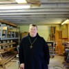 Lawrence Stasyszen, abbott of St. Gregory's Abbey, stands inside the monastery's condemned workshop in Shawnee, Okla. The monastery and associated college are still reeling from millions in damage from a 5.7-magnitude quake that struck in 2011.