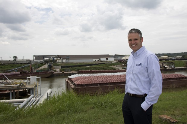 Port of Catoosa Deputy Director David Yarbrough stands at the across the the port's main dock, where a barge is being unloaded.