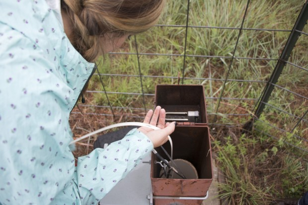 OWRB water resources geologist Jessica Correll feeds water tape into a well on the Garber-Wellington Aquifer that underlies central Oklahoma.