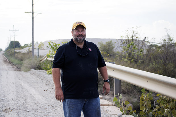 University of Oklahoma professor Bob Nairn stands on a bridge overlooking Tar Creek, which is contaminated with arsenic, cadmium, iron, lead and zinc from decades of mining.