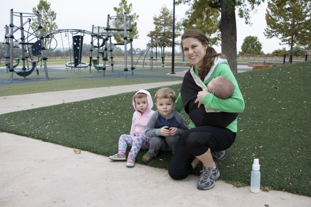 Tulsa resident Julianne Romanello with her children at the 41st Street Plaza, a popular city park along the Arkansas River.
