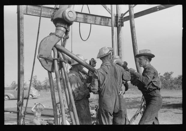 Workers in an oil field near Seminole, Okla., in 1939.