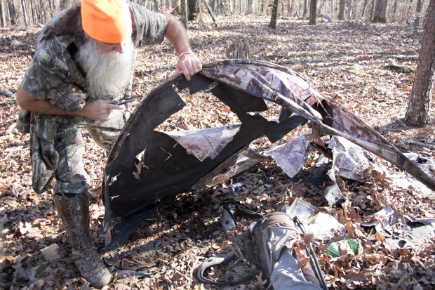 Charles Benton examines the destroyed campsite he says he ran from after seeing Bigfoot.