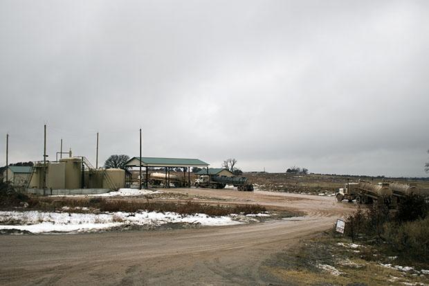 Oilfield trucks line up at Overflow Energy's Oakwaood No. 1 disposal well in western Oklahoma.