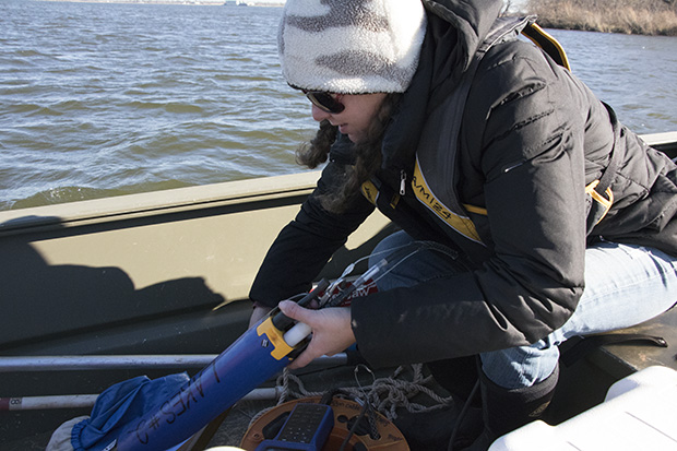 Jet Stein with the OWRB's lake monitoring program prepares to test the water at Lake Hefner in Oklahoma City.