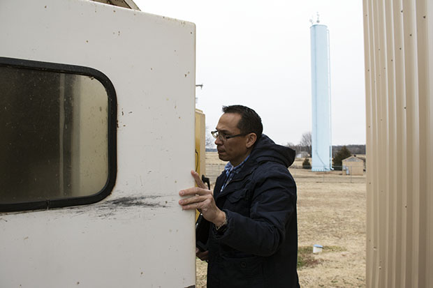 Vance Pennington, a regional manager for the Oklahoma Department of Environmental Quality, inspects a chlorine treatment system at a water treatment plant in Chandler, Okla.