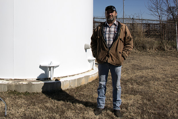 Dale Kennedy, operator of the water system in McCurtain, Okla., near the town's water tower in January 2016.