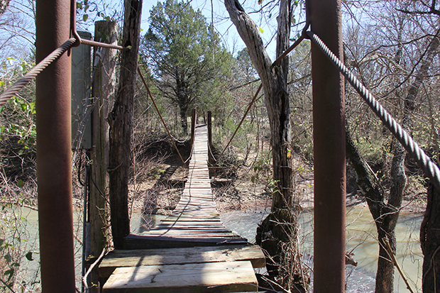 The swinging bridge over a tributary of the Kiamichi River that leads to Ruby Burns' house.