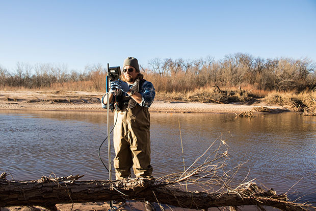 Oklahoma Water Resources Board project coordinator Jason Murphy takes water samples at the Canadian River east of Oklahoma City.