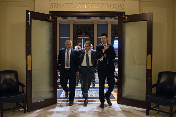 State Senators Greg Treat, Clark Jolley and David Holt emerge from a Republican Caucus meeting after members agreed on a framework for a $6.8 million state budget.