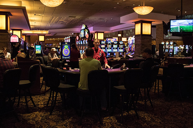 A dealer and players inside the Citizen Potawatomi Nation's Grand Casino Hotel and Resort in Shawnee, Okla.