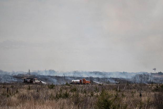 Fire crews work to reduce wildfire danger by clear brush through a prescribed burn in northwestern Oklahoma in April 2016.