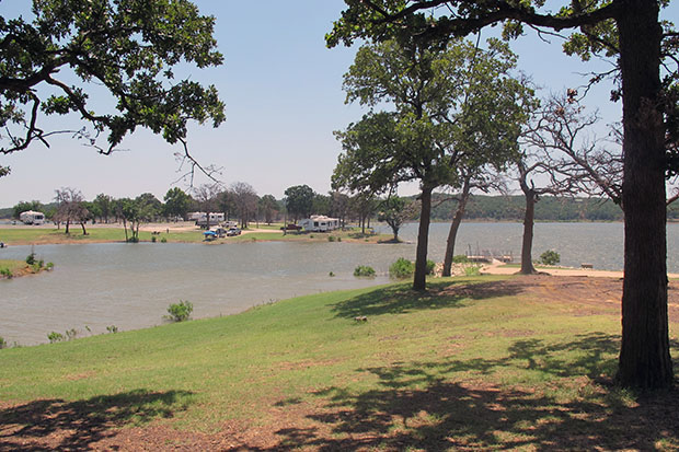 A campground at Lake Texoma State Park is dotted with campers, even on a weekday morning.