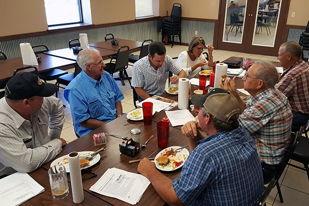 Area ranchers talk about black vultures during the monthly meeting of Latimer County Farm Bureau members at The Eaton Hole in Wilburton, Okla.