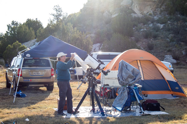 An amateur astronomer covers up his telescope shortly after sunrise at the 2016 Okie-Tex Star Party.
