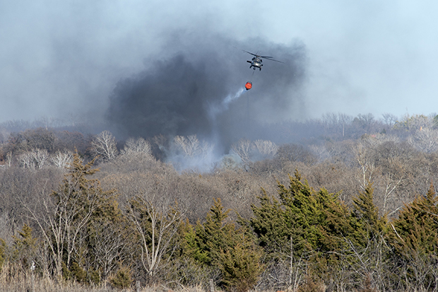Oklahoma Army Guardsmen were called out to support local firefighters in Edmond on January 24. Eight Soldiers on two UH-60 Blackhawk helicopters equipped with Bambi Buckets flew nearly three hours and dropped 30 buckets, releasing around 19,800 gallons of water on a wildfire that engulfed houses in the area.