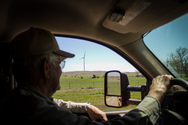Bob Kerr on his ranch near Carnegie, Okla., which is flanked by turbines from the Blue Canyon Wind Farm.
