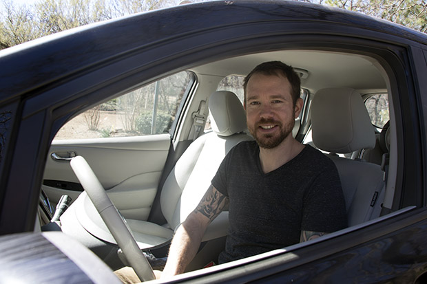 Edmond resident Jonathon Stranger in his 2013 Nissan Leaf, an all-electric car.