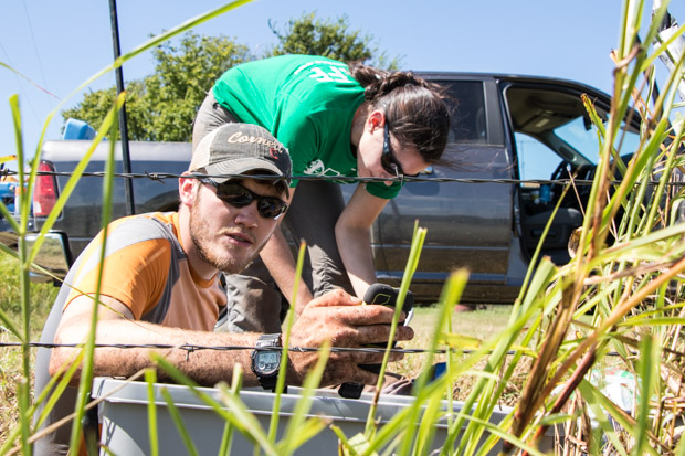 Researchers Nate Stevens and Hannah Rabinowitz calibrating a seismometer near Pawnee, Okla.