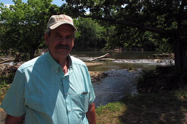 Oklahoma Conservation Commission Executive Director Trey Lam on the bank of the Blue River in south-central Oklahoma.