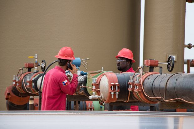 Electricians perform final checks on equipment nearing a tank battery at the Barton Water Recycling Facility.