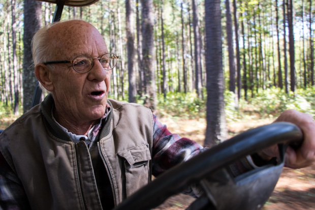 Jerry Gutierrez steers his golf cart on a tour of his ranch near the Kiamichi River in southeastern Oklahoma. Gutierrez and other nearby residents urged the state not to approve Oklahoma City's permit to tap water from river.
