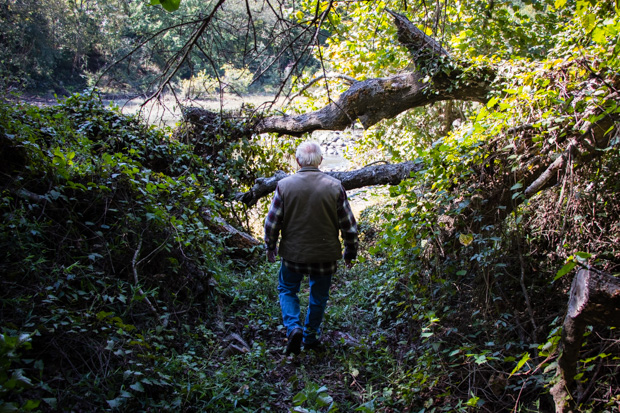 Jerry Gutierrez walks down a trail to the Kiamichi River.