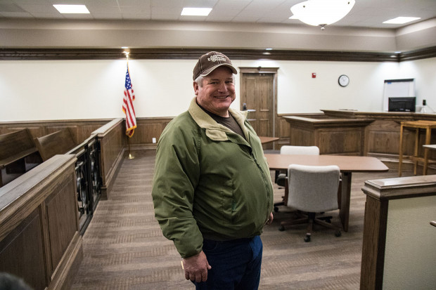 County Commissioner Junior Salisbury in the courtroom at the Dewey County Courthouse in Taloga, Okla. Sales tax revenues from nearby wind farms helped the county pay off the new building before it opened, Salisbury said.