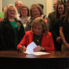 Flanked by teachers from the Professional Oklahoma Educators organization, Governor Mary Fallin signs a new teacher pay raise into law. March 29, 2018.