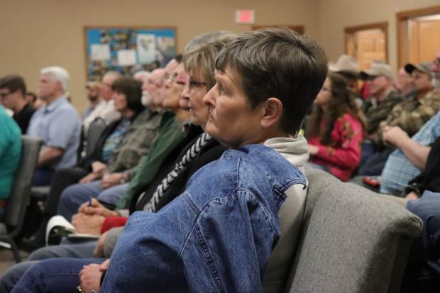 Linnae Colson listens to Jim McBride's presentation at First United Methodist Church.
