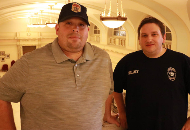Jason Page and Paul Mullaney inside the state Capitol on Tuesday.