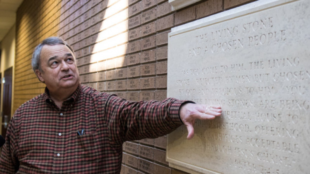 A brick wall at First Baptist Church in Broken Arrow, Okla., is inscribed with the names of people who donated to the church's relocation. Among the names is Scott Pruitt.