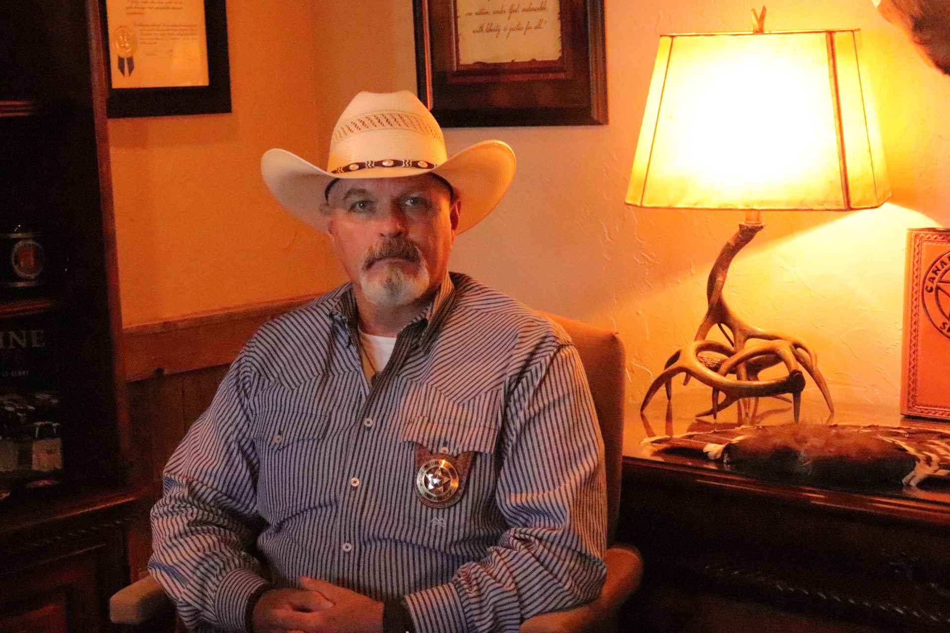 Canadian County Sheriff Chris West sits in his office.