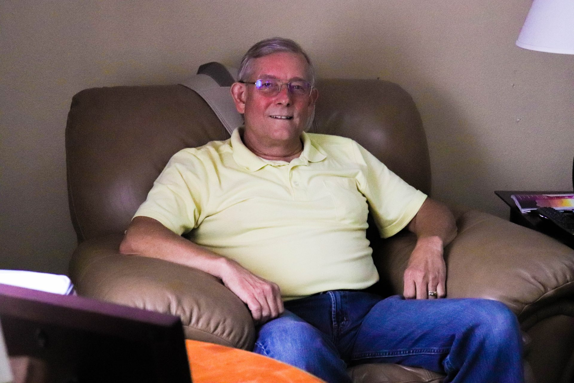David Rowden sits in an armchair in his Chandler, OK home.
