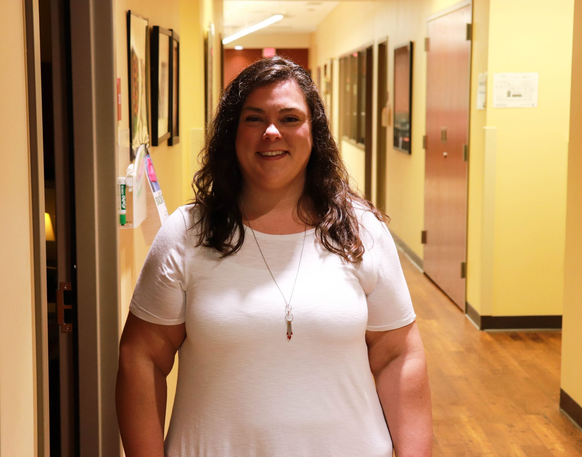 Amanda Gaddy stands in the hallway at Women in Recovery.