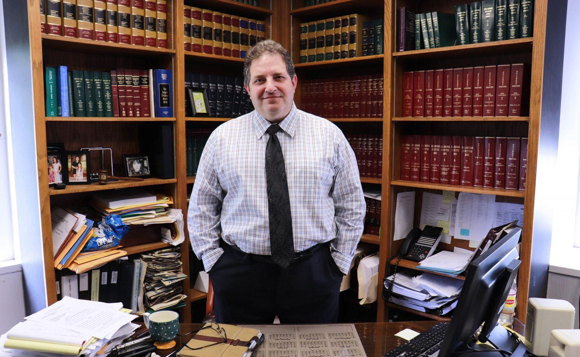 Judge Pickerill stands behind his desk in his courthouse office.