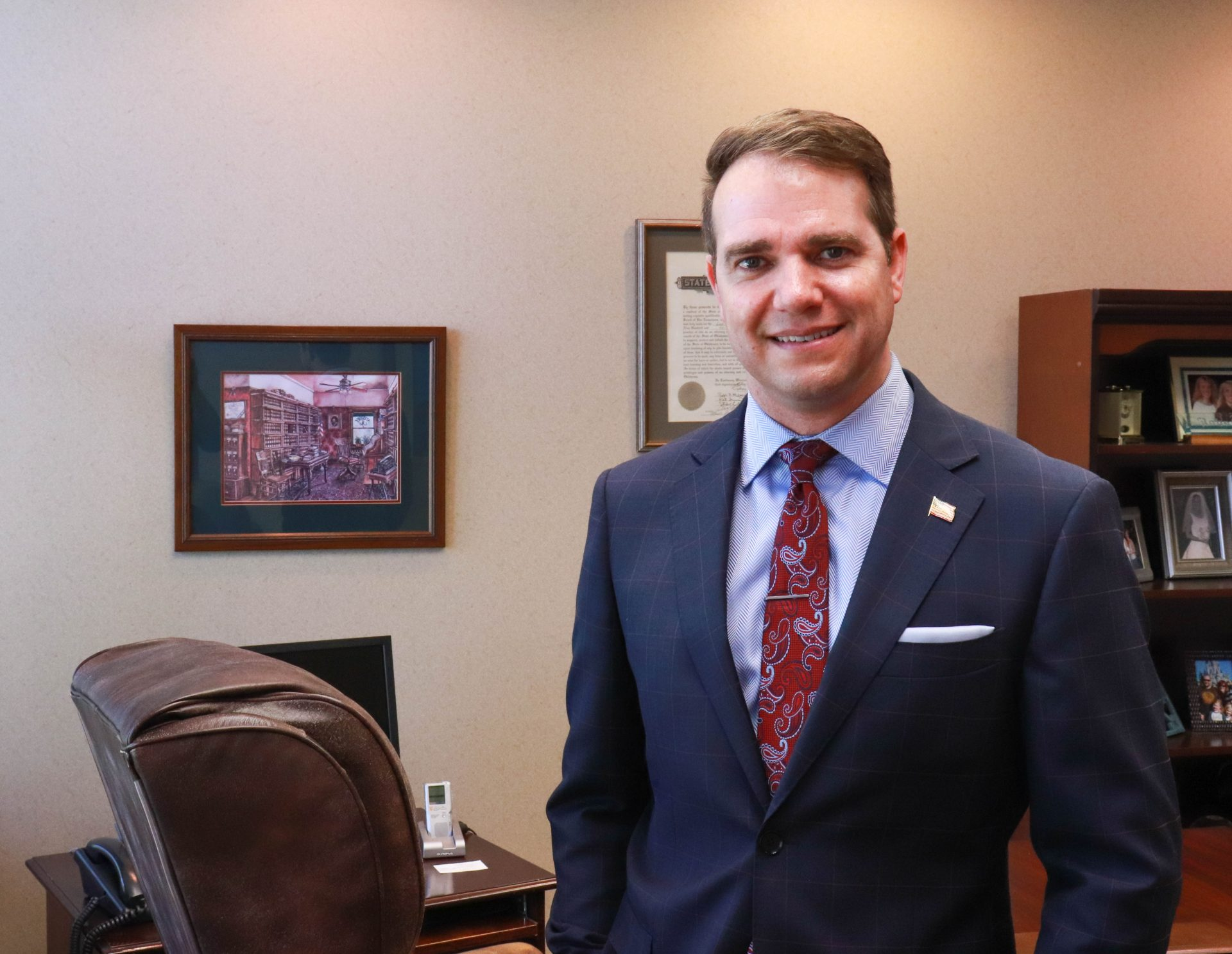Randy Grau stands in an office at his law firm.
